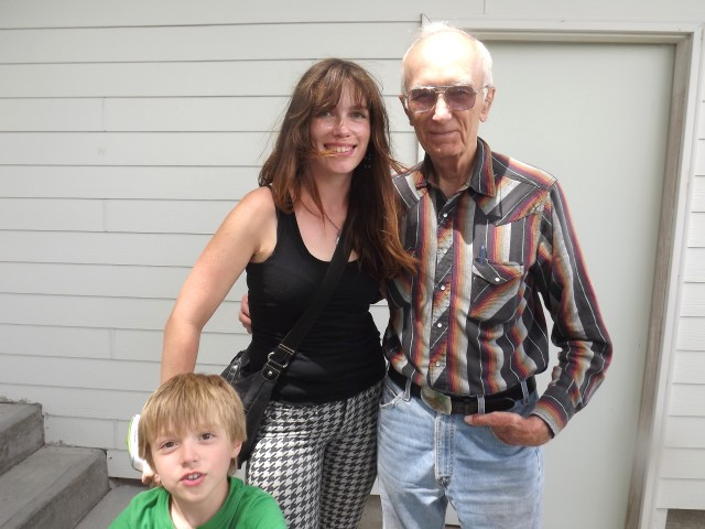 Becky and Max with Tom Huffman on his front porch in Nenzel.